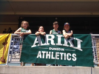 Kids with Club Banner Ariki Athletics